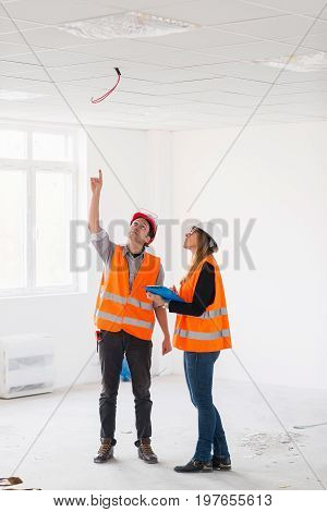 Maintenance Engineers Checking Cables For Fire Sprinkler, Color Image, Indoors