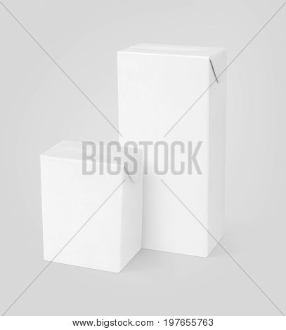 Group of different milk or juice carton packages on gray background with clipping path