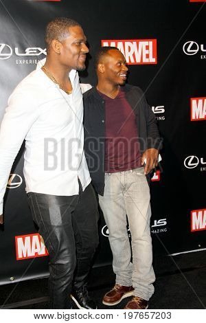 SAN DIEGO - July 22:  Jason Moore, Malcom Goodwin at Marvel and Lexus Black Panther Party at Comic-Con at the Parq Nightclub on July 22, 2017 in San Diego, CA