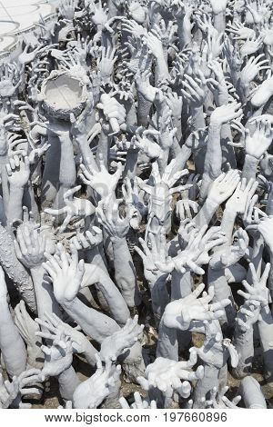 Chiang Rai, Thailand - April 20,2017 : Sculpture of face at the White temple named Wat Rong Khun in Chiang Rai, Thailand.