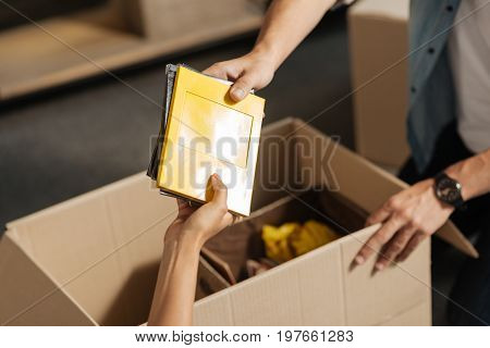 My albums. Young people collecting their things while going to remove their apartment