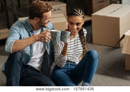Our new flat. Positive delighted couple feeling happiness while having new flat