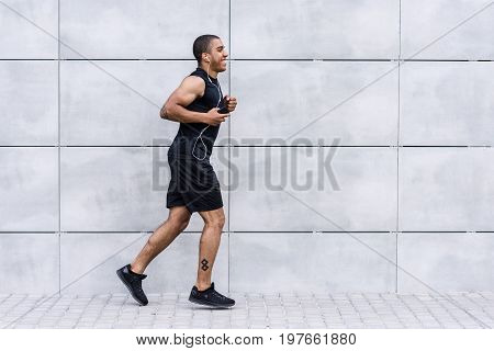 African American Sportsman Running On Street