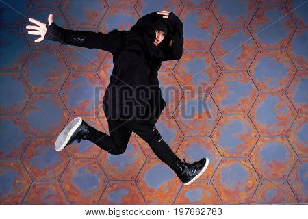 Young hip-hop dancer jumping high. Urban style