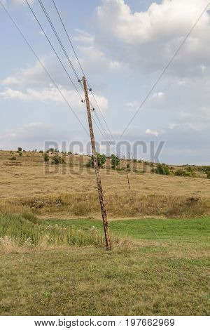 Leaning Wooden Electrical Poles