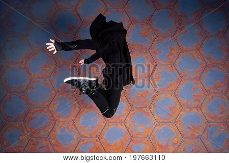 Young hip-hop dancer jumping high. Urban style.