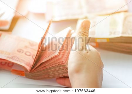 close up image of female hand count the money, business accounting background