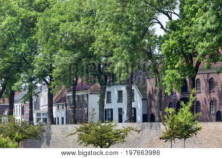 Street and old city wall fortification in Buren in the Netherlands