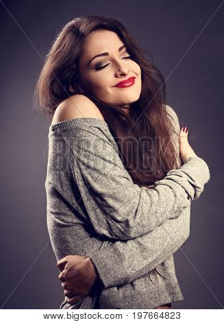 Happy Makeup Woman With Red Lipstick Hugging Herself With Natural Emotional Enjoying Face In Grey Fa