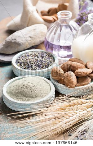 Nature cosmetics handmade preparation with essential oils and ancient minerals of parfums skincare creams soaps from fresh and dried lavender flowers wheat almond nuts green clay powder in French artisanal boutique home style
