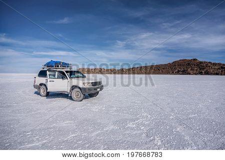 Uyuni, Bolivia- March 25, 2017: Off- road car on lake Salar de Uyuni Bolivia