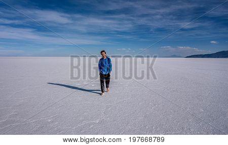 Uyuni, Bolivia- March 25, 2017: Man walking on the lake Salar de Uyuni Bolivia
