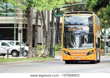 Honolulu Hawaii - May 25 2016: Pink Line Waikiki Trolley Bus. The Waikiki Trolley transport system is the easy fun and affordable way to experience Waikiki and Honolulu.