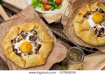 Savoury tarts with bacon mushrooms chicken and eggs