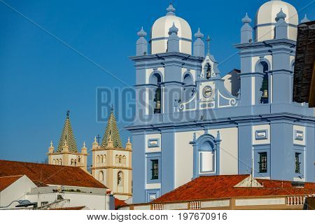 Long shot view of blue and cream facade in churchs in Angra do Heroismo, Island of Terceira in Azores, Portugal