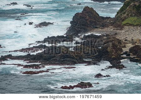 Long view of volcanic rocks, castle shape in the ocean, terceira, azores islands