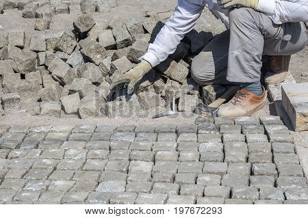 Worker Installing Granite Cubes