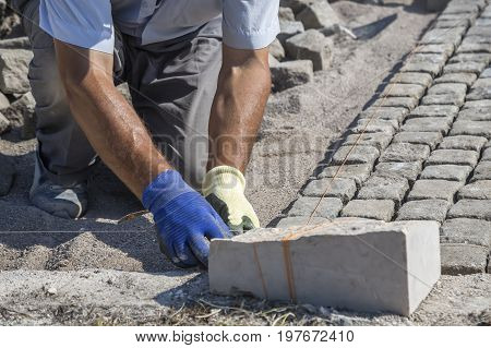 Worker Installing Granite Cubes 2
