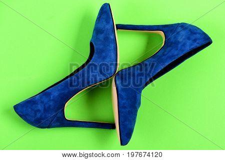 Shoes In Dark Blue Color. High Heel Footwear On Green