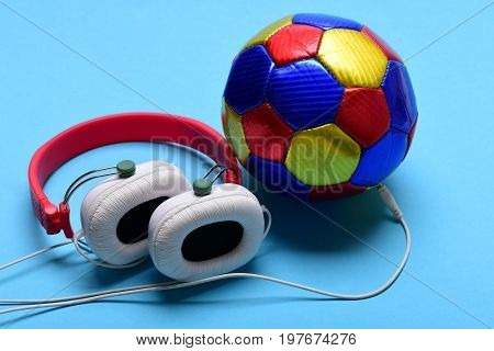 Modern Earphones And Football On Turquoise Background