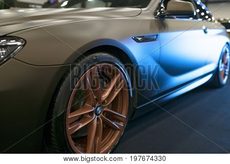 Sankt-Petersburg Russia July 21 2017: Side view of a Tuning BMW M6 coupe 2017 in blue tones. Matt color .Car exterior details. Photo Taken at Royal Auto Show July 21