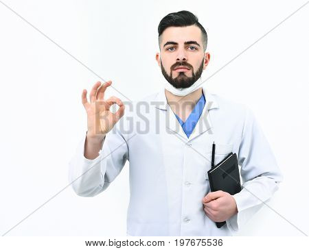 Doctor With Beard Holds Notebook For History Of Illness