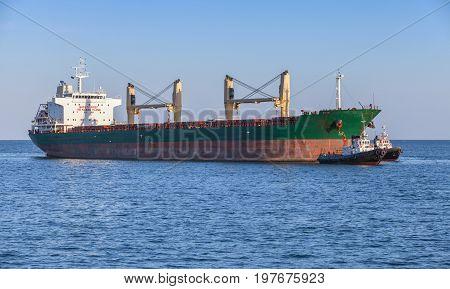 Bulk Carrier And Tug Boats. Big Cargo Ship