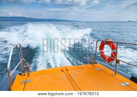 Red Lifebuoy Hanging On Stern Railings