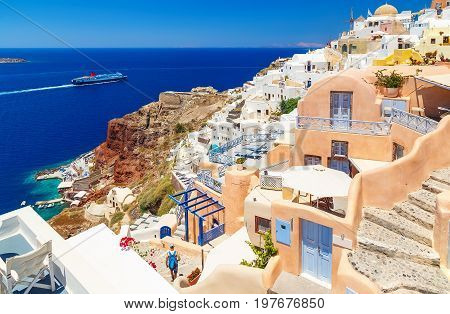 Greece Santorini island in Cyclades, traditional sights of colorful and white washed walk paths like narrow streets and caldera sea