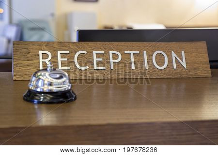 Bell With Reception Sign On Front Desk