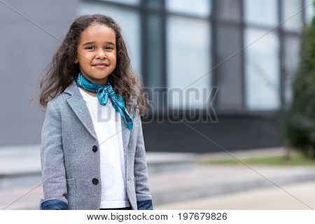 Portrait Of Beautiful Small Beautiful African American Girl Smiling At Camera While Standing Near Sc