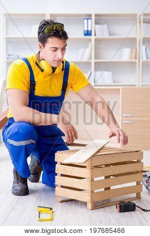 Repairman carpenter inspecting examining  a wooden board plank