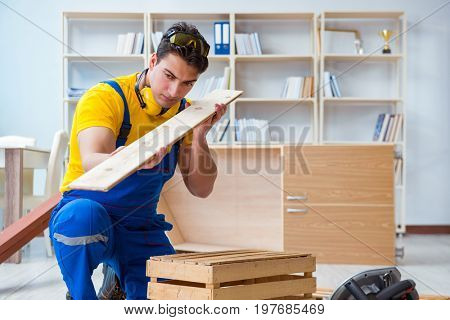 Repairman carpenter inspecting examining  a wooden board plank