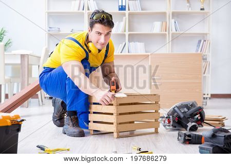 Repairman carpenter working with wooden board plank and measurin