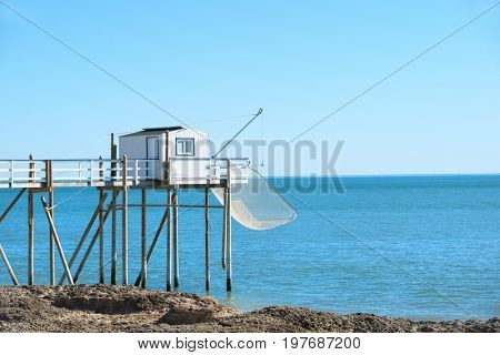 wooden fisherman cabins at the coast