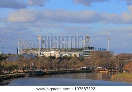 MELBOURNE AUSTRALIA - JULY 1, 2017: Melbourne Cricket Ground along Yarra river in Melbourne Australia