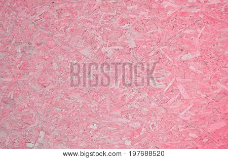 Pastel pink compressed wooden chips feminine colored background