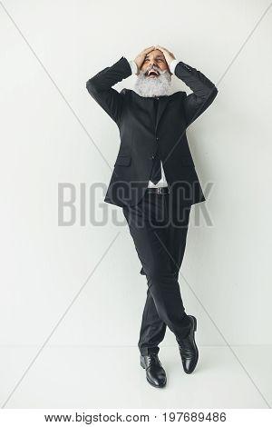 Happy Loughing Senior Businessman On White Background