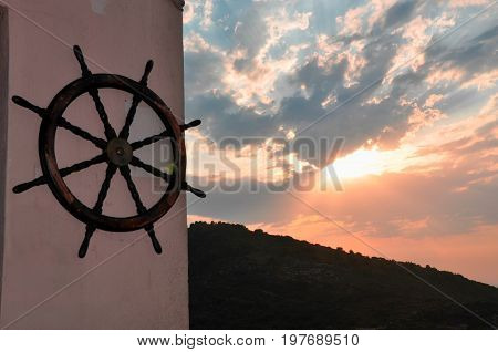 Abstract photo with old wooden rudder decoration on wall
