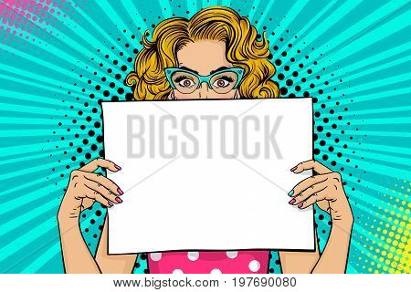 Wow female face. Sexy young blonde woman with wide open eyes in glasses holding blank board for your offer. Vector colorful background in pop art retro comic style. Party invitation poster.