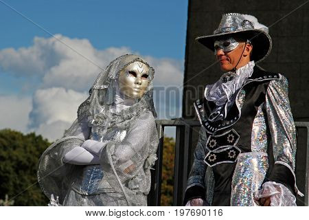 Moscow Russia - August 01 2015: Portrait of a street actor in carnival mask and on stilts at the festival