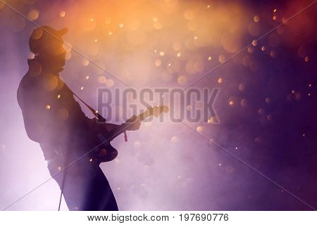 Guitarist on stage, night entertainment, music festival
