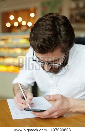 Contemporary man filling in application for vacancy