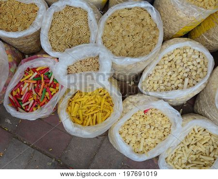 Selling Nuts And Dried Fruits At A Bazaar In India