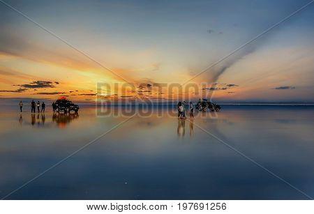 Uyuni, Bolivia- March 25, 2017: Sunset at lake Salar de Uyuni in Bolivia