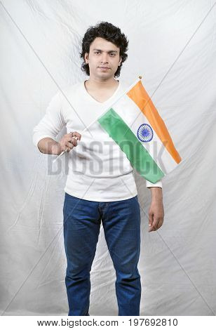 young indian male boy holding indian flag