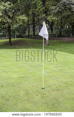 White Golf Flag On A Field