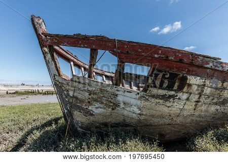 Wreck at the boat cemetery at low tide in Noirmoutier (France)