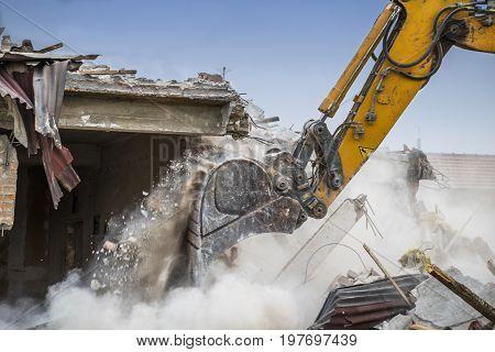 Close Of Excavator Arm Demolishing