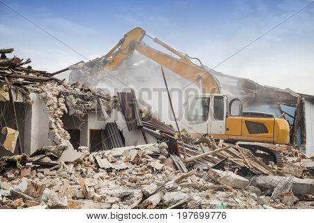 Excavator Demolishing Barracks